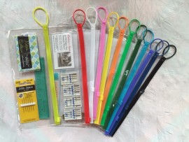 Vinyl clear bags with multicolored closures, hook and pocket